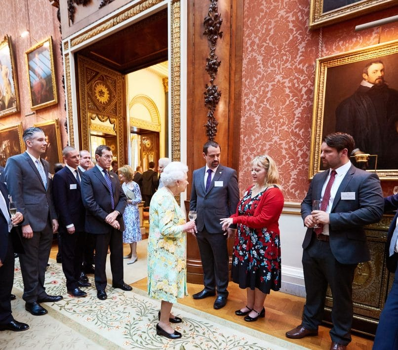The Queen talking with the guests